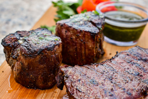 Grilled Filets on Cutting Board with bowl with Cilantro Pesto