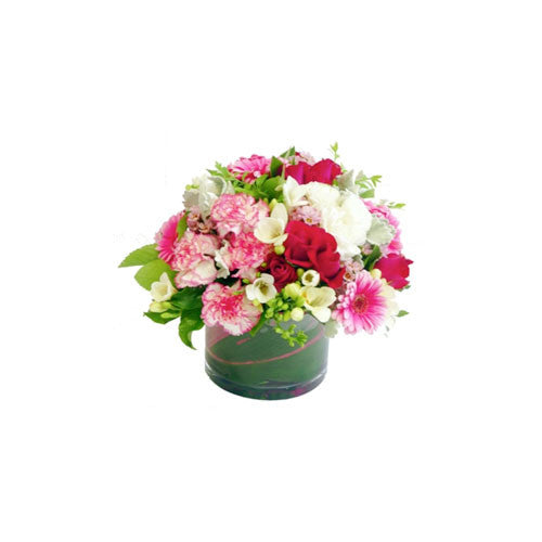 Seasonal Flowers in Small Cylinder Glass Vase