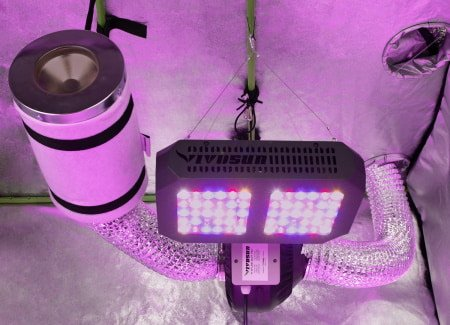 This is a picture of a fan and filter setup in a grow tent.