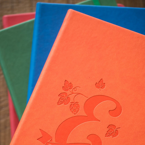 Four notebooks with E logo