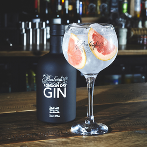 Burleigh's Signature Gin in a glass next to bottle