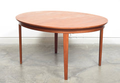 Extending oval dining table by Gunni Omann