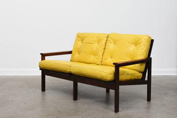 Capella sofa in rosewood by Illum Wikkelsø