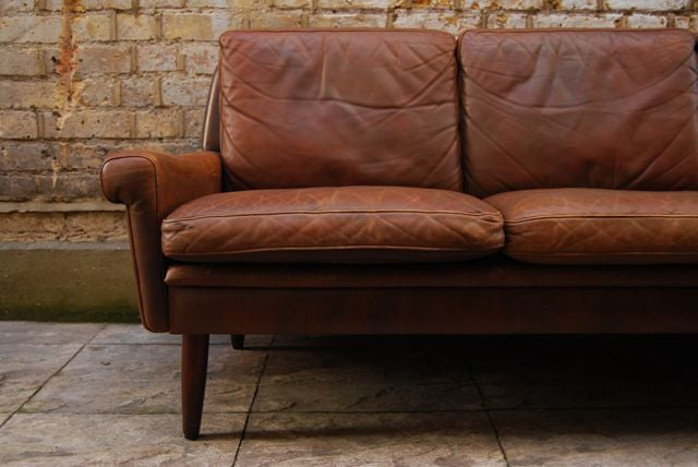 Brown three seat leather sofa by Skipper