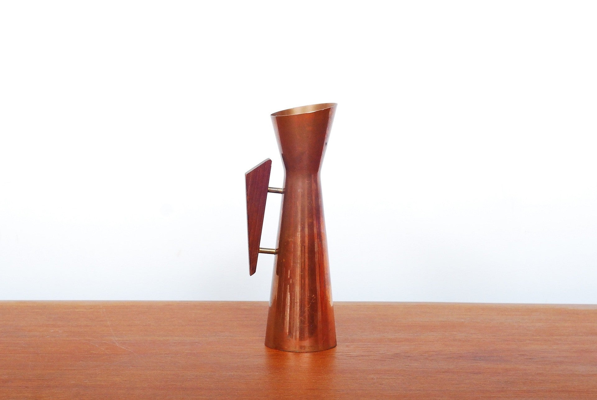 Copper vase with teak handle