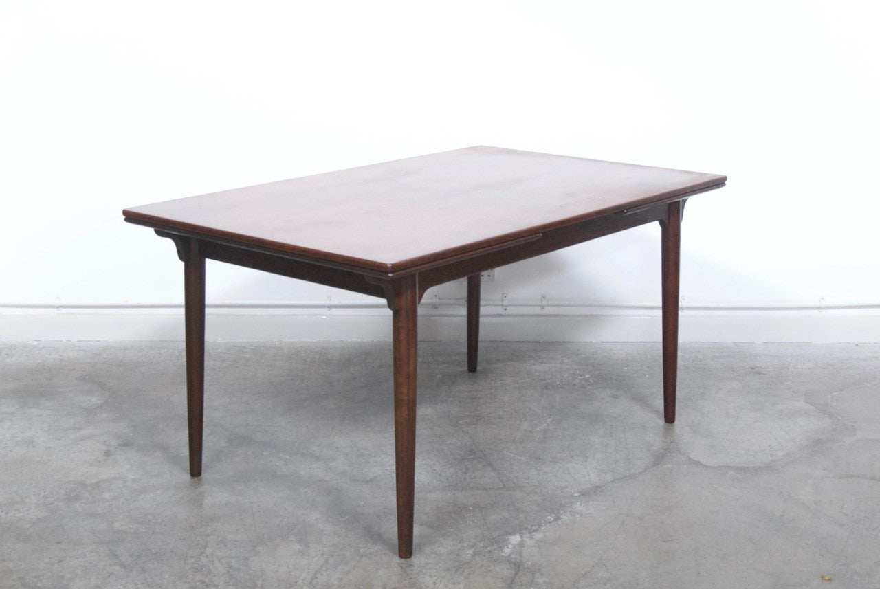 Extending rosewood dining table by Omann Junior