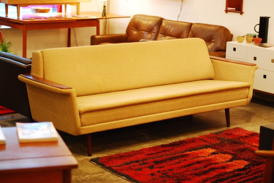 Sofa bed with rosewood arms