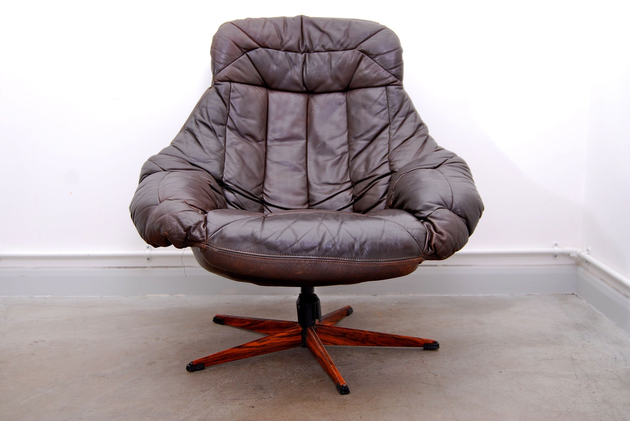 Leather bucket chair by H.W Klein