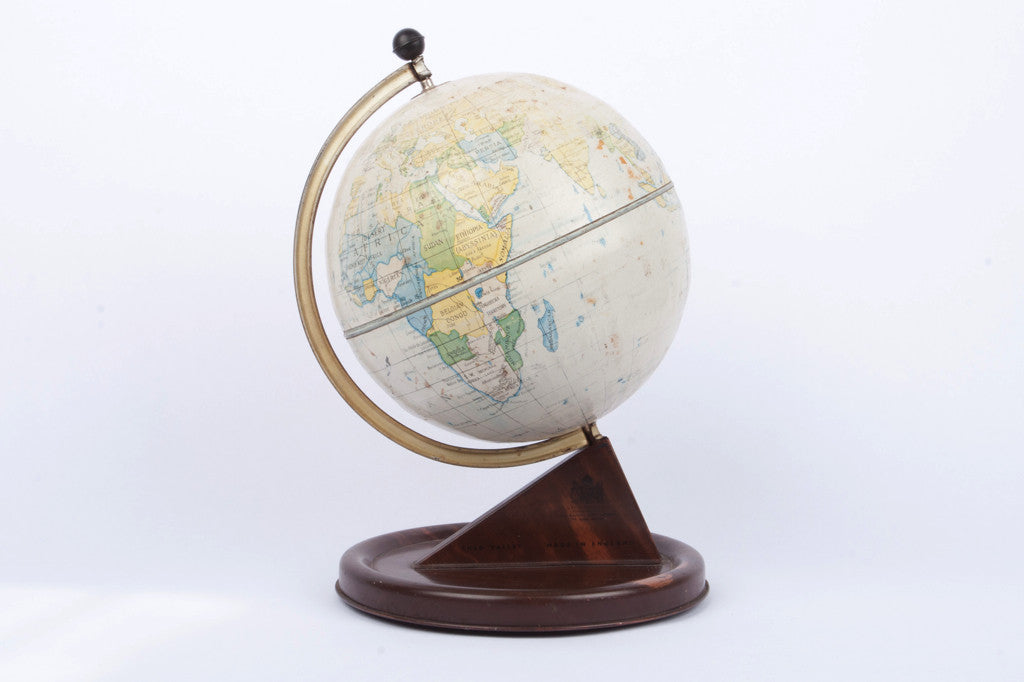 Vintage globe on wooden base