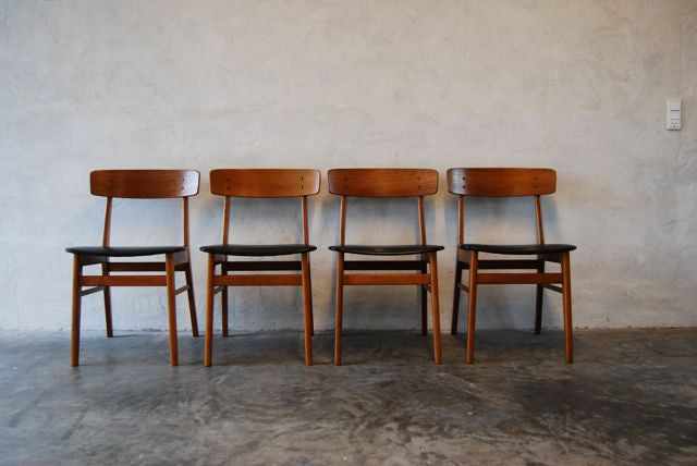 Set of four dining chairs in teak and leatherette