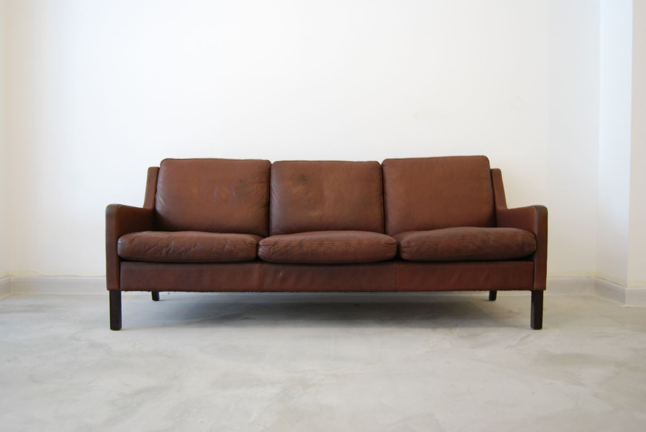 Chase & Sorensen Three seat leather sofa by George Thams