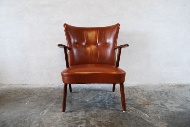 Leather occasional chair in teak
