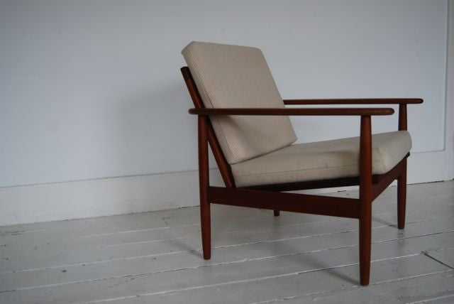 Lounge chair in oiled teak