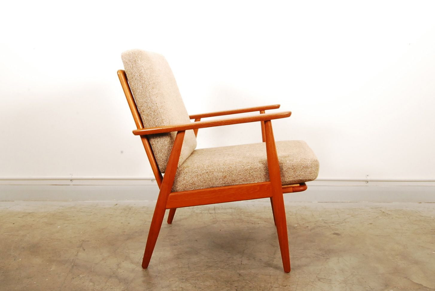Teak lounge chair with wool cushions