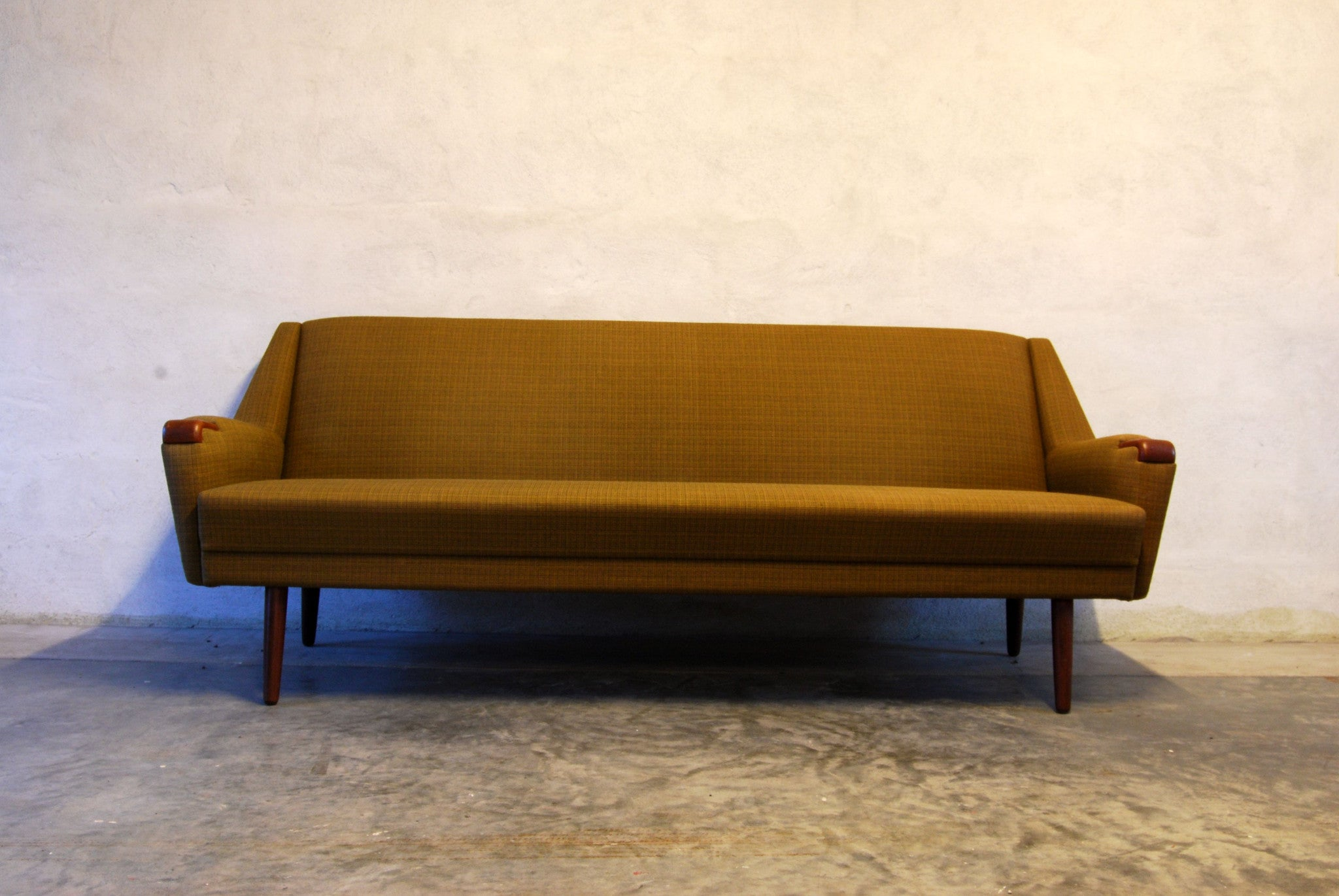 Three seat sofa with teak paws