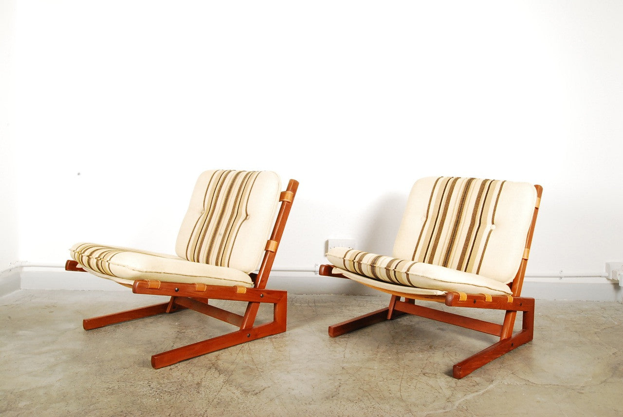 Pair of low loungers in teak