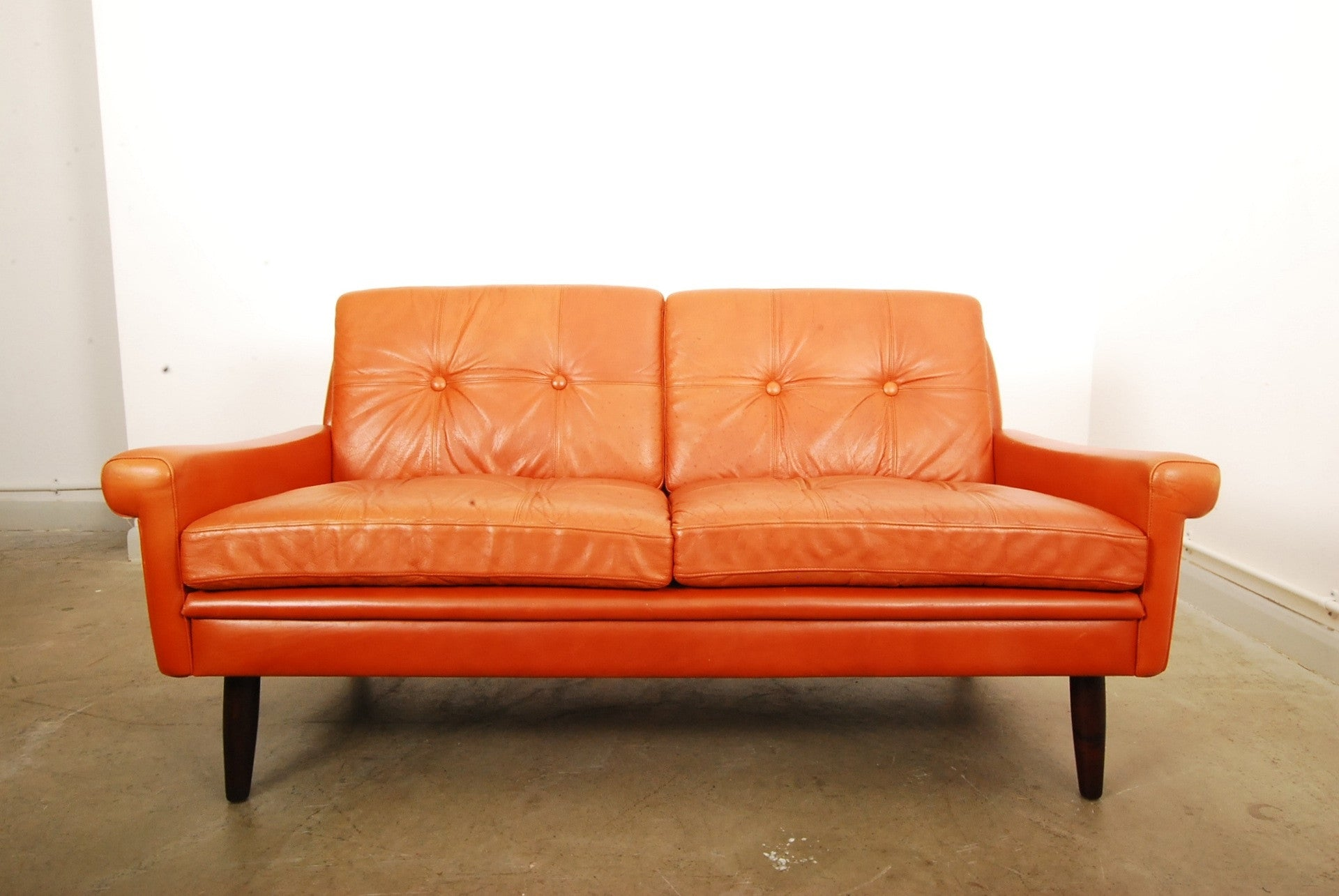 Two seat leather sofa by Skipper