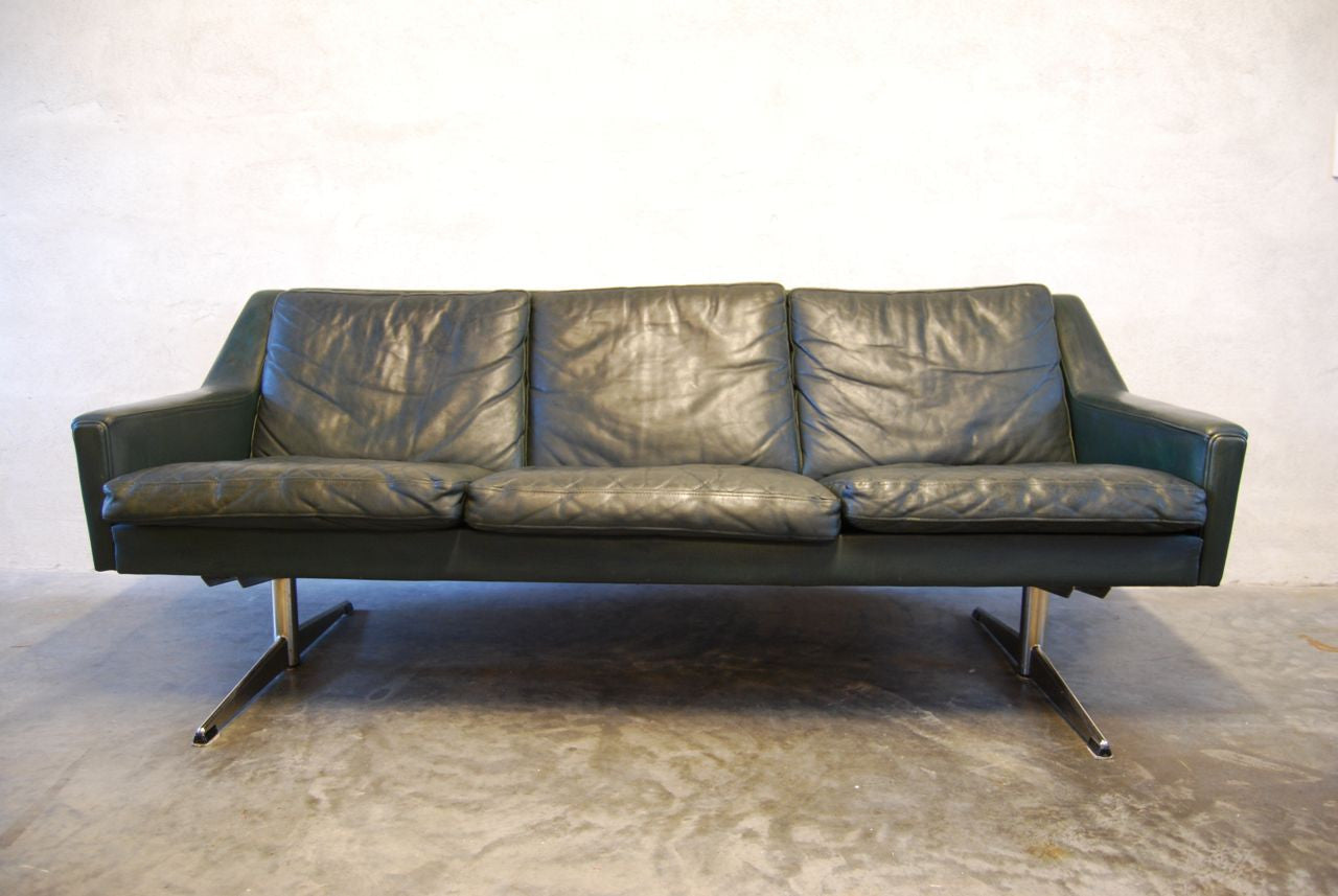 Three seat leather sofa in forest green