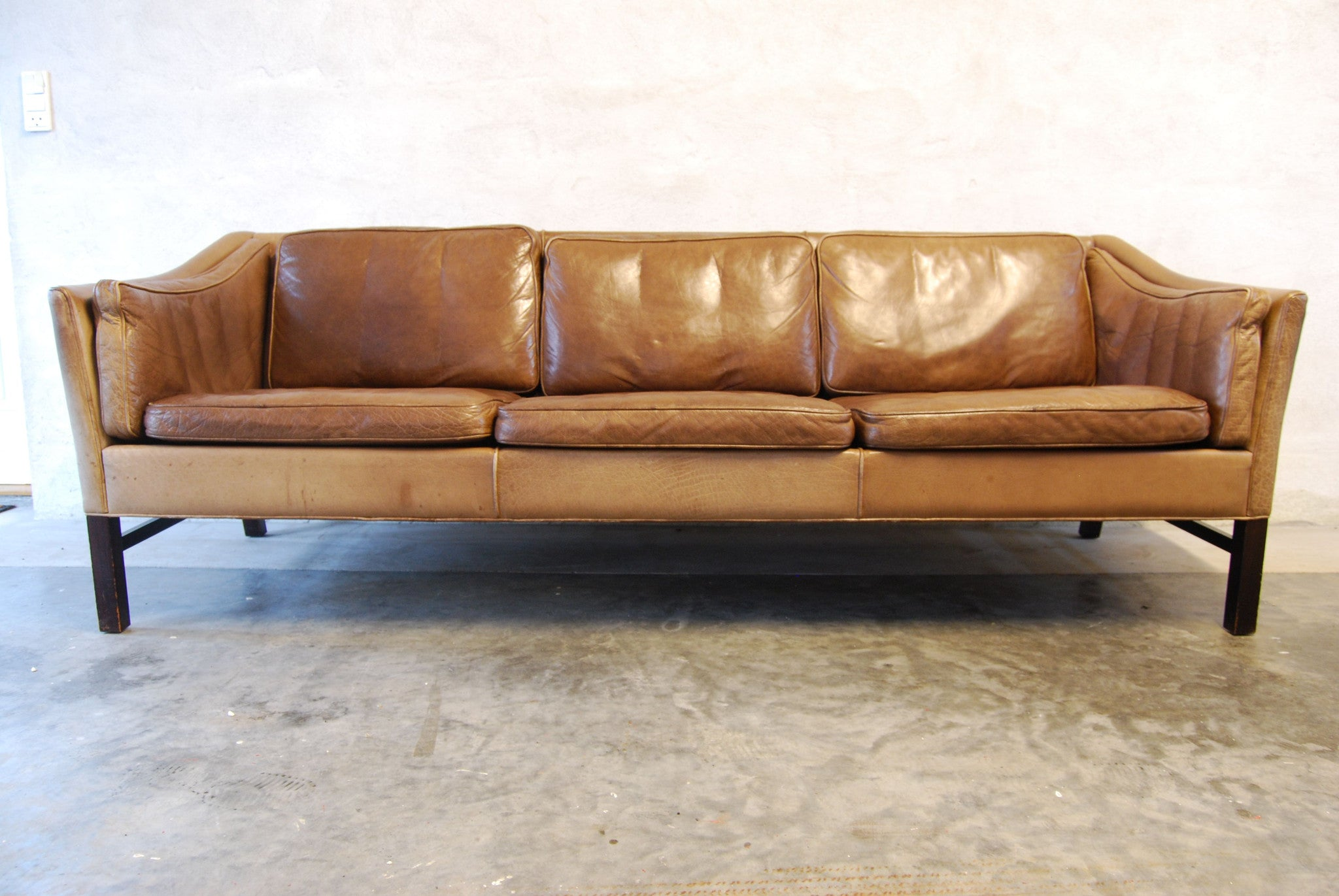 Chase & Sorensen Three seat leather sofa with scalloped back