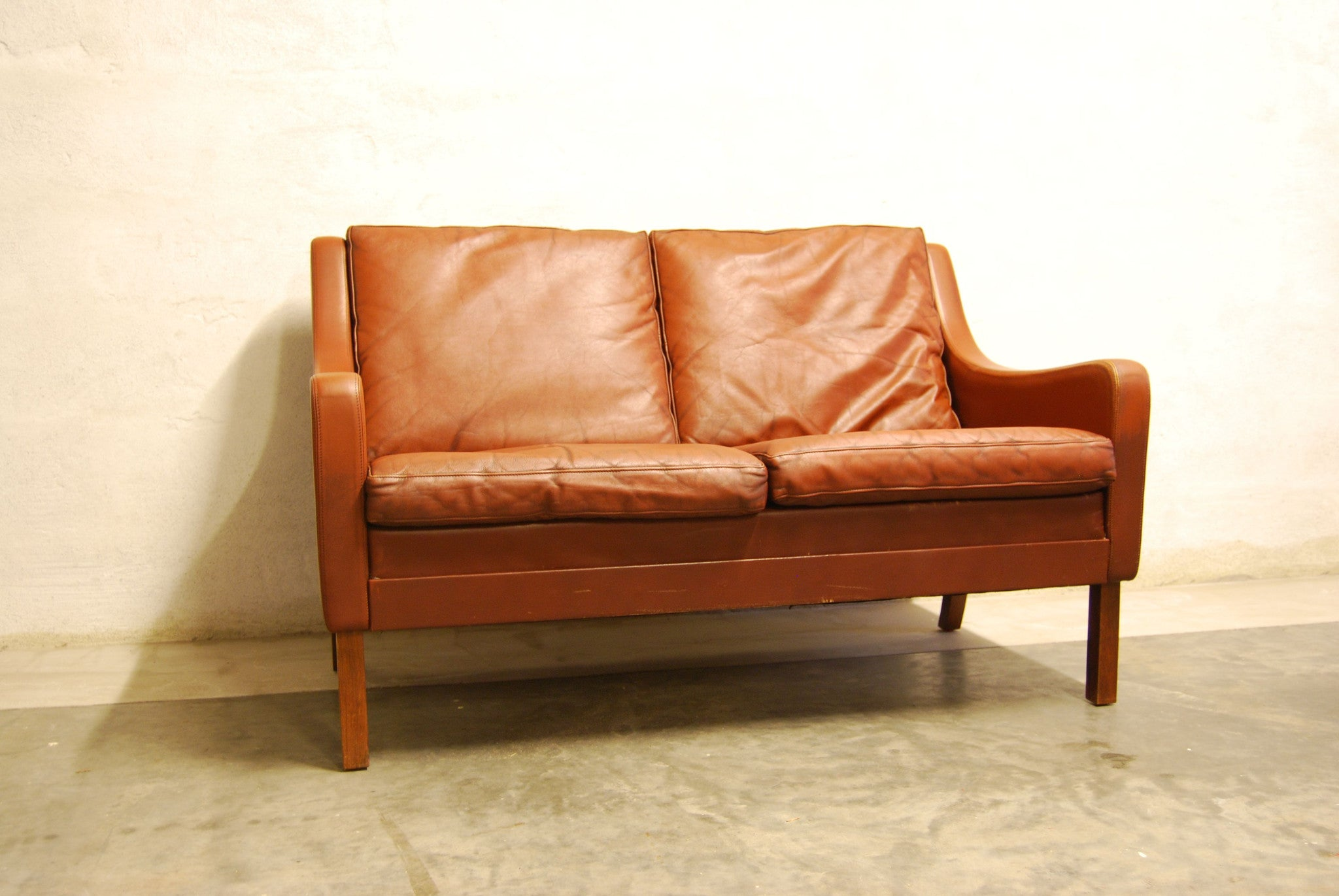 Maroon leather two seater
