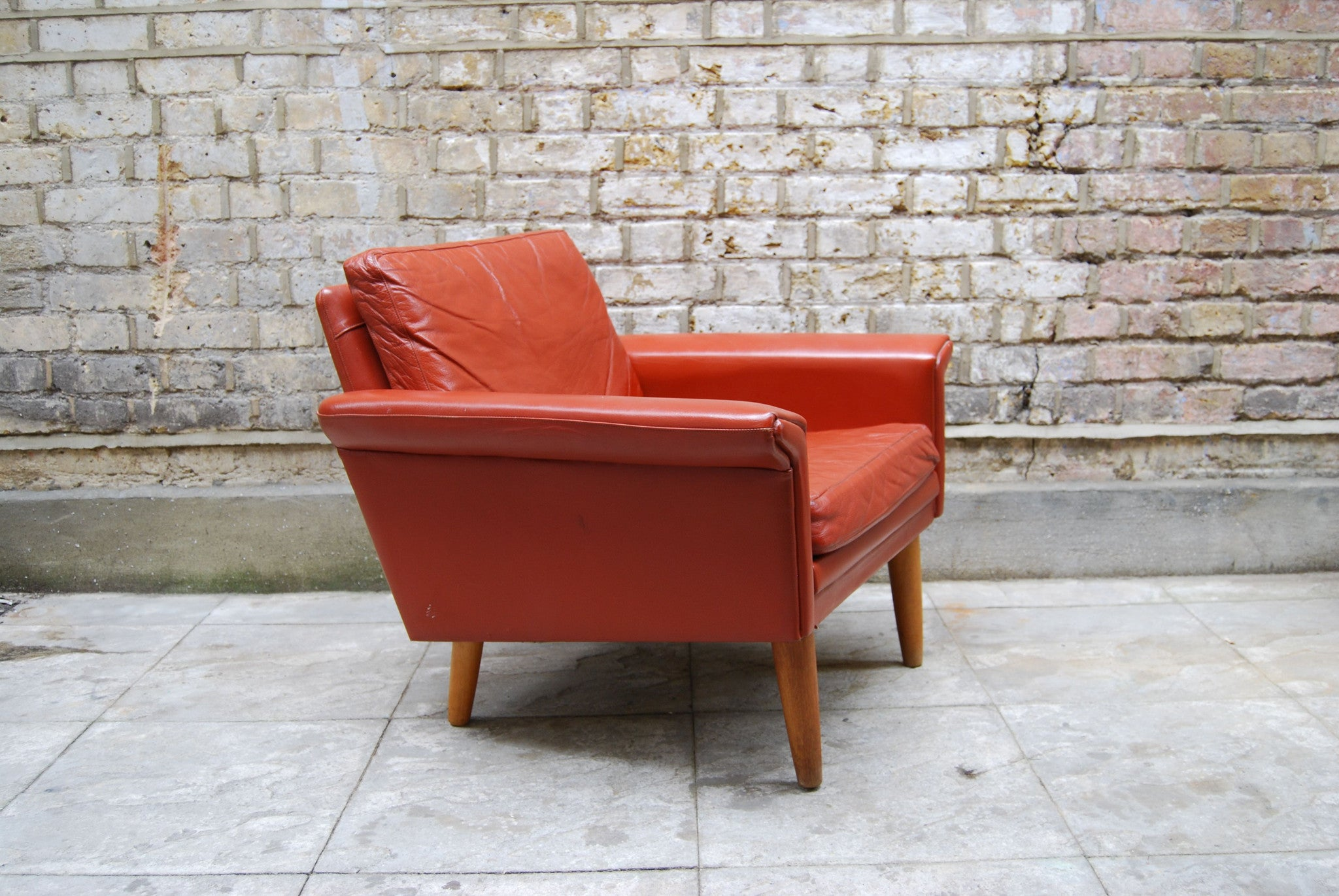 Lowback lounge chair in red leather