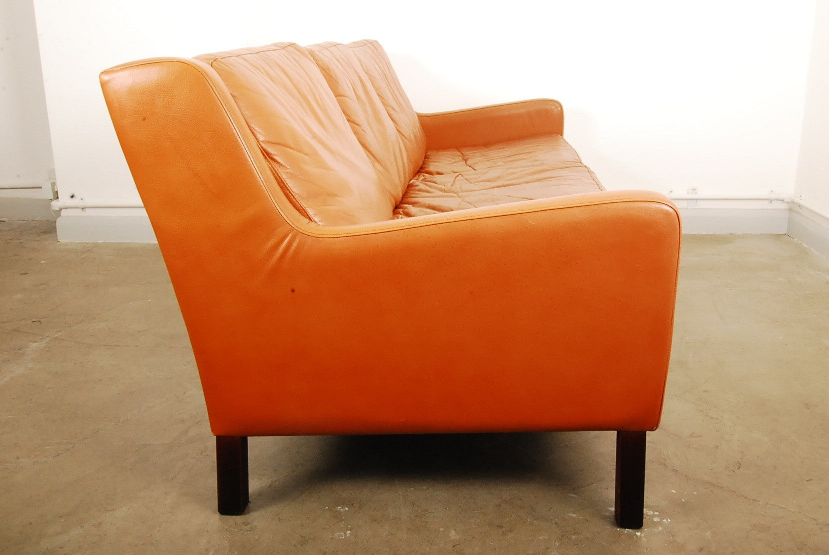 Three seat tan leather sofa