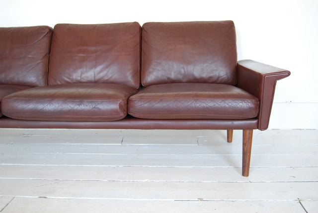 Three seat leather sofa with rosewood legs
