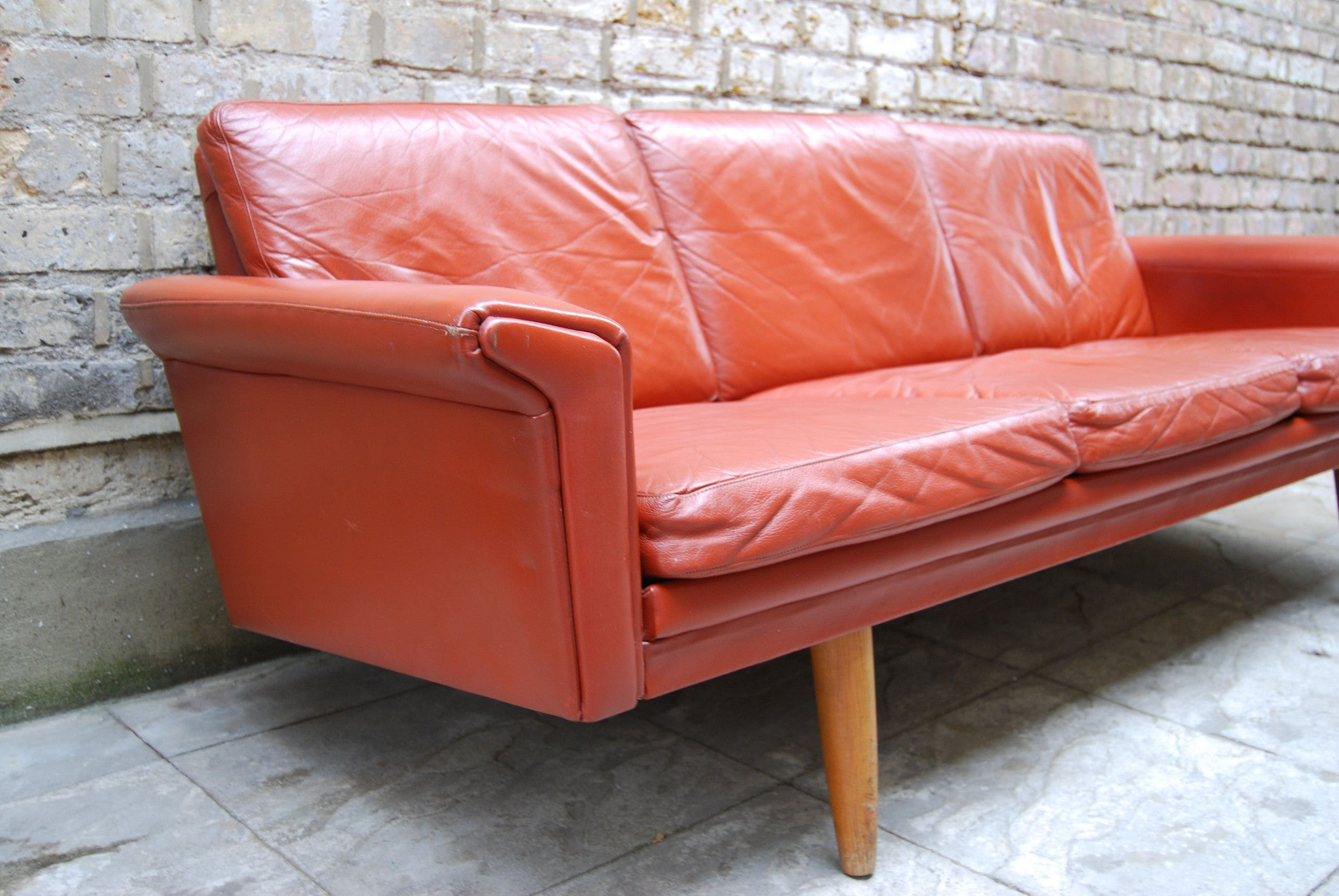 Three seat red leather sofa