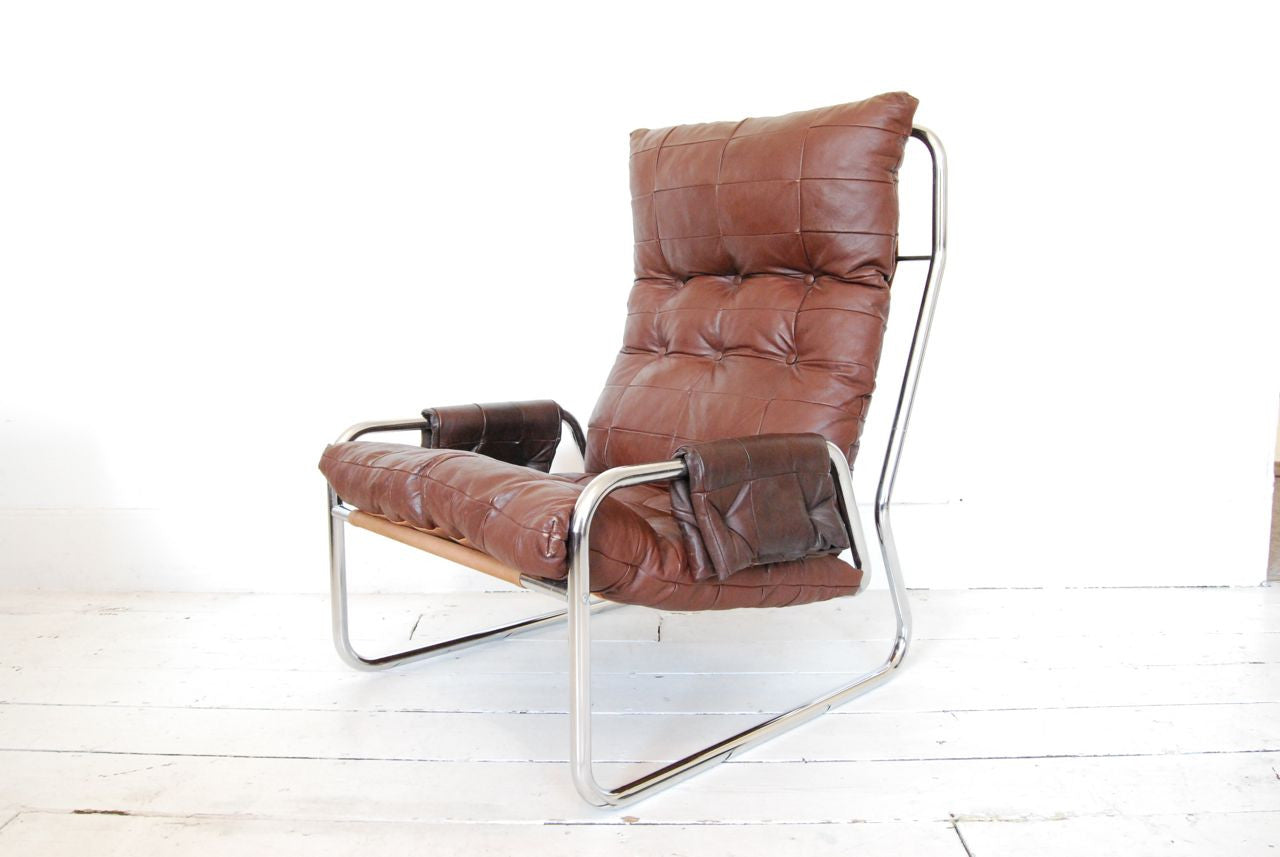 Lounge chair in leather, canvas and chrome base