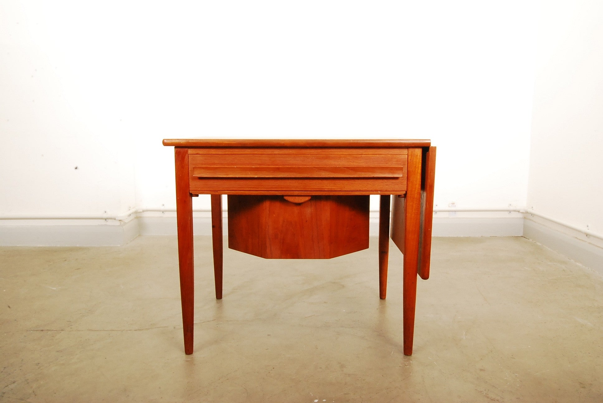 Extending teak sewing table