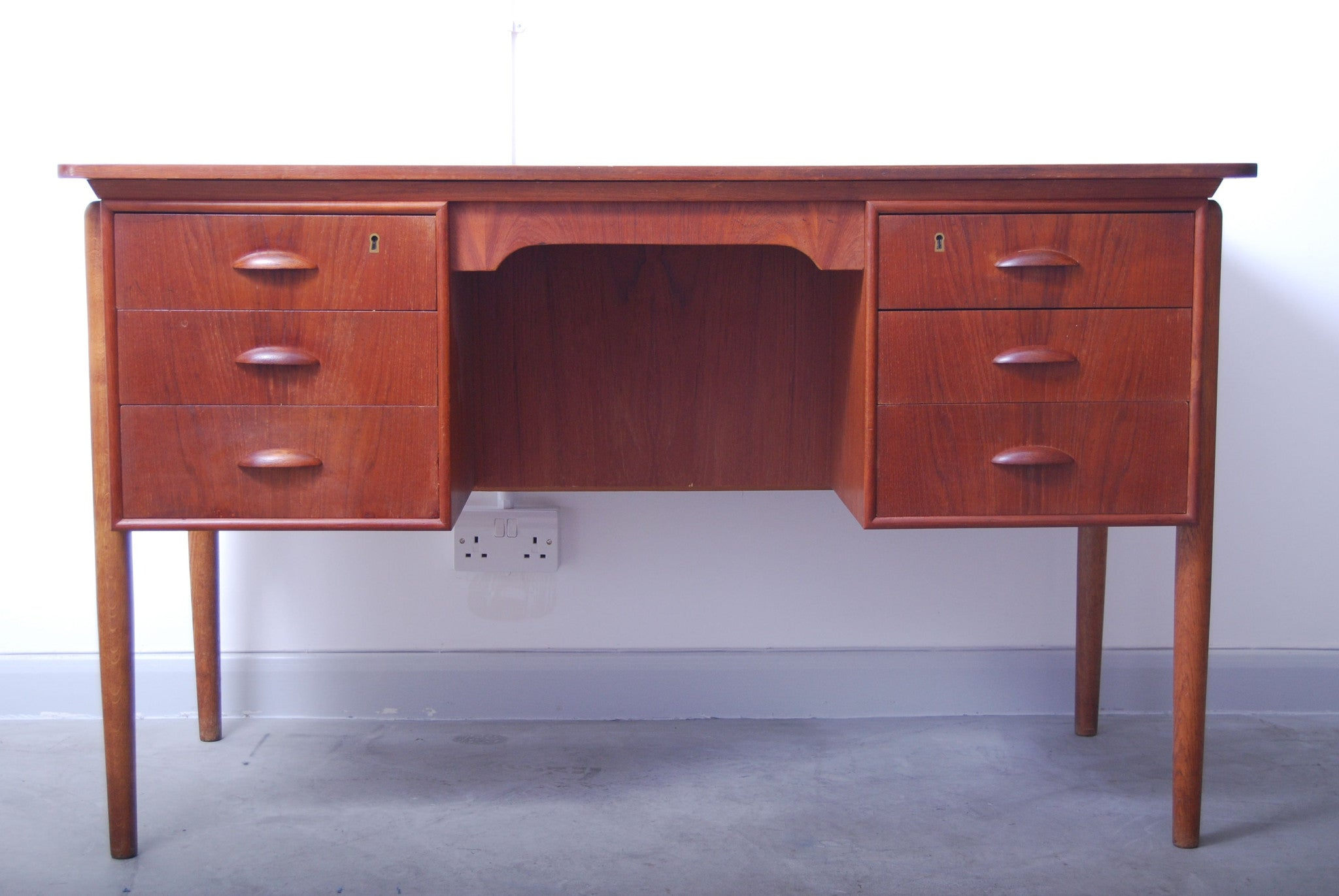 Teak desk w/ six drawers