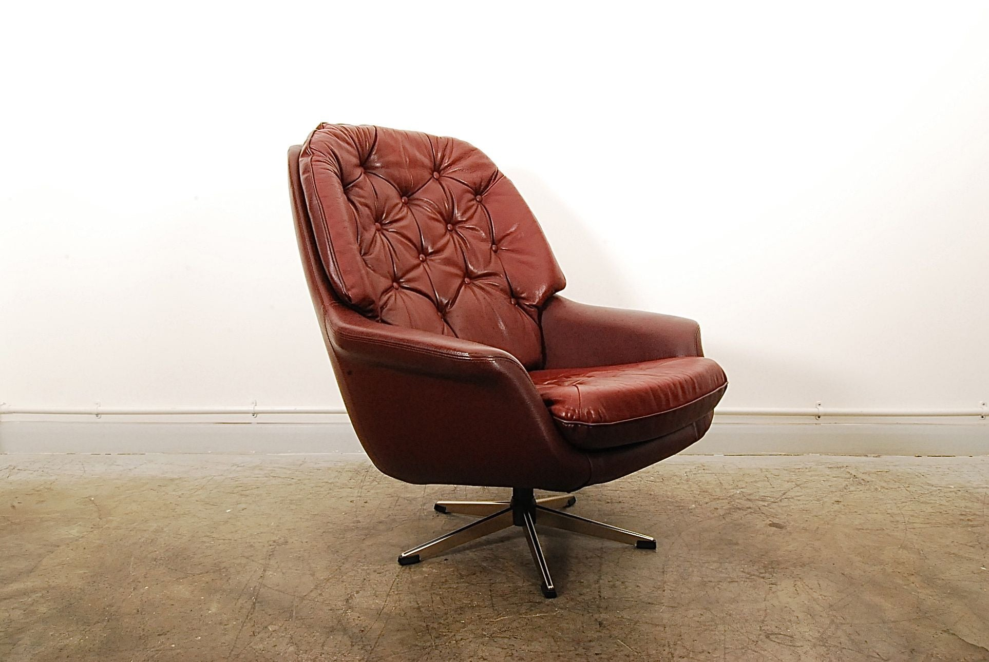 Maroon leather bucket chair