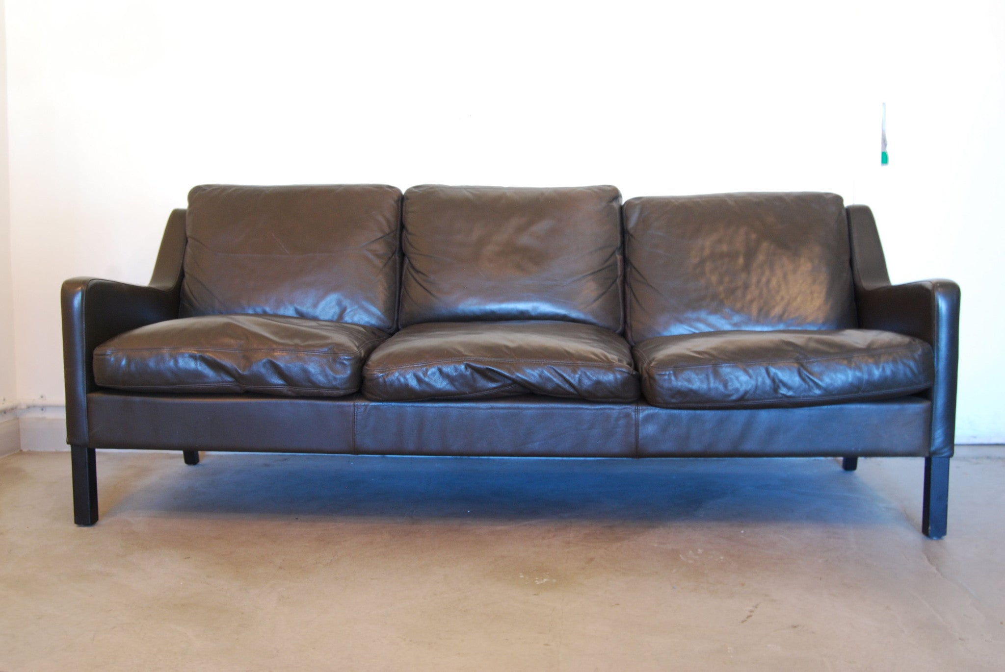Three seat sofa in black leather