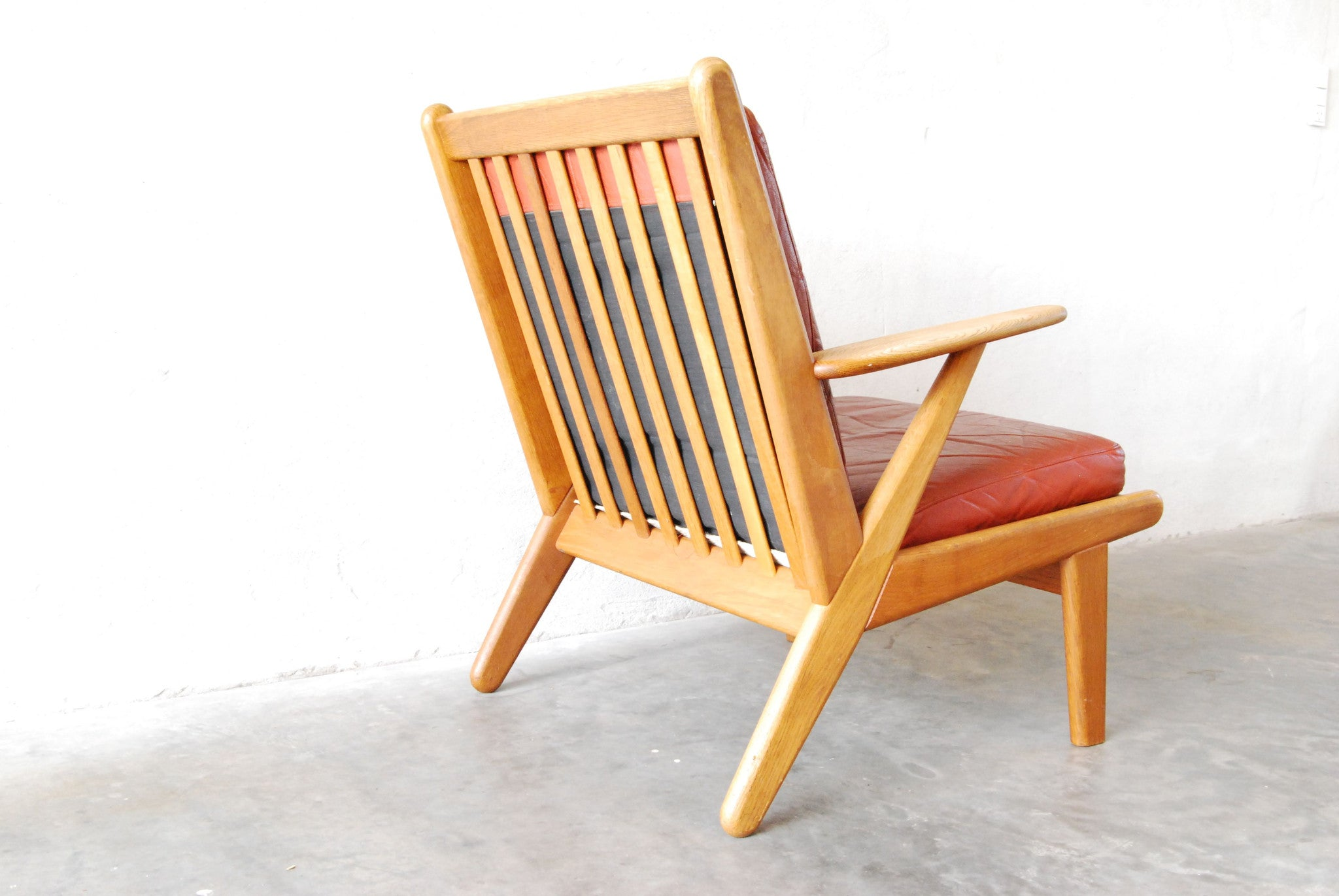 Pair of oak lounge chairs by Poul Volther