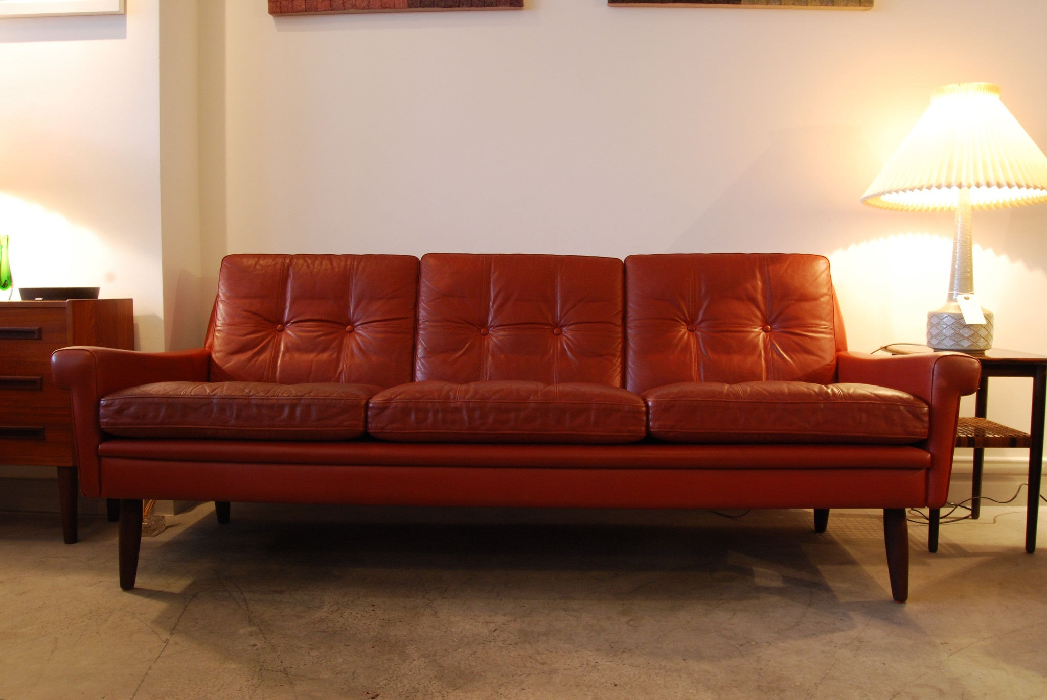 Three seat sofa in red leather