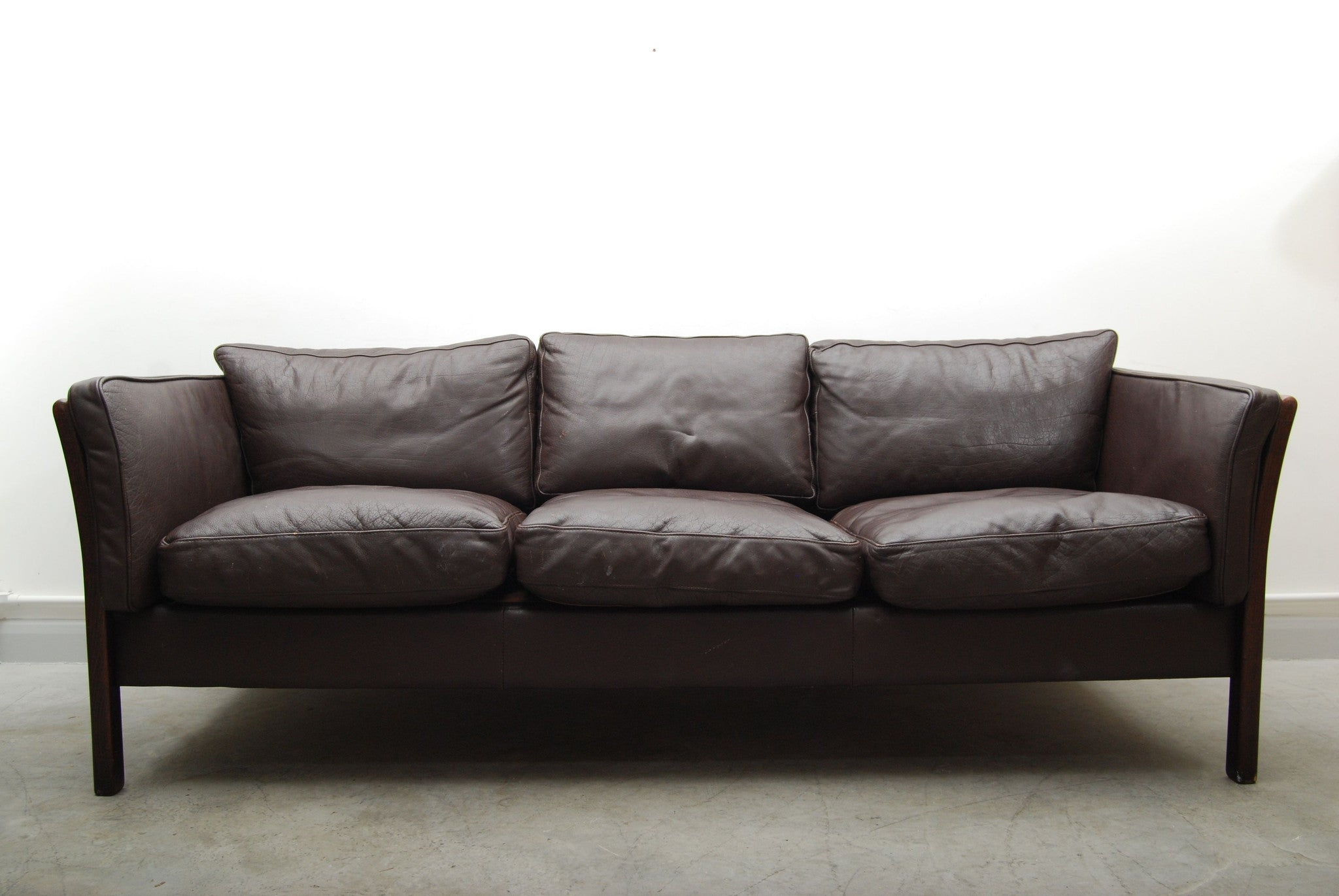 Three seat leather sofa with beech frame