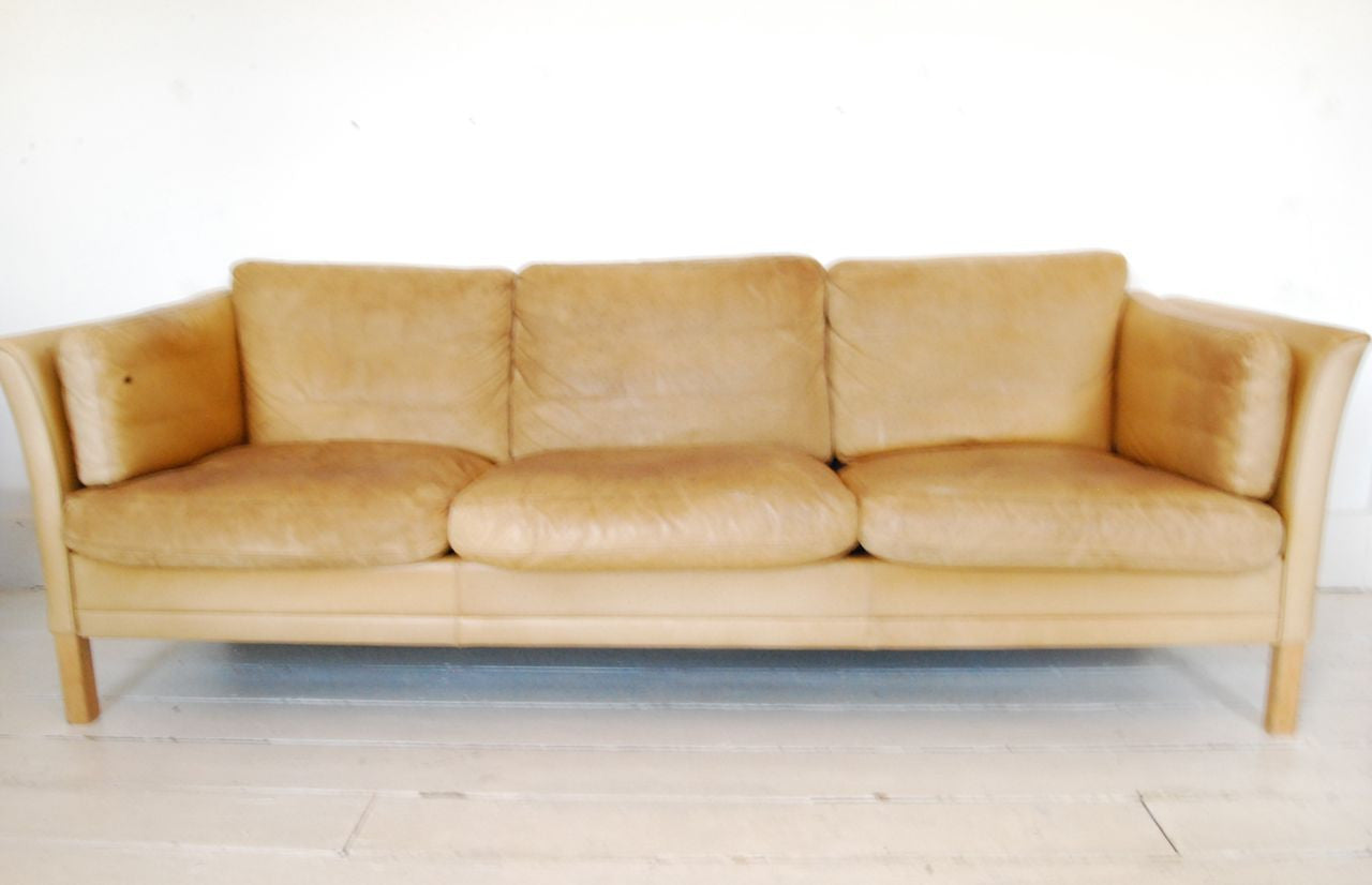 Three seat leather sofa by Mogens Hansen