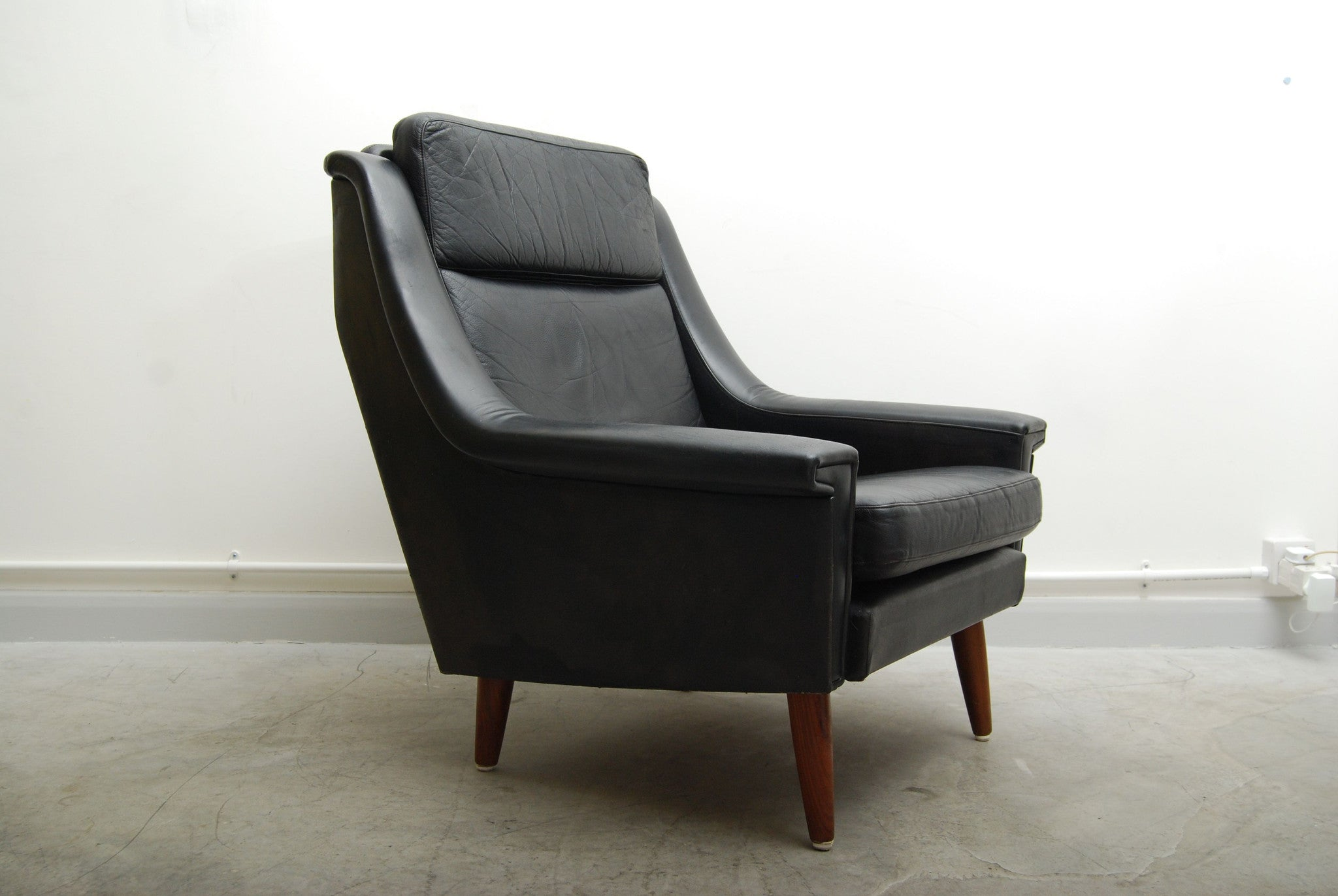 New price: Black leather lounge chair