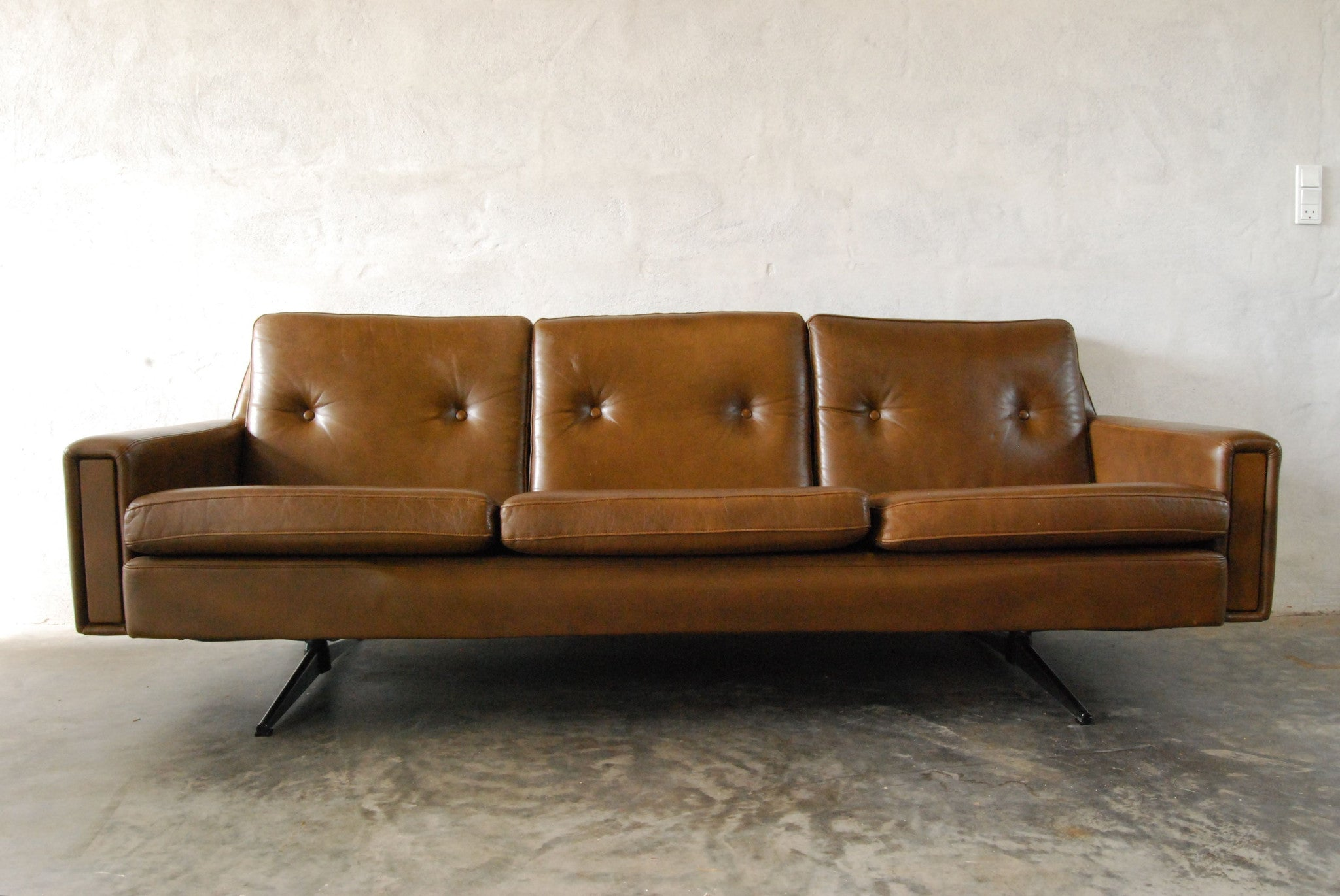 Leather three seater with chrome base