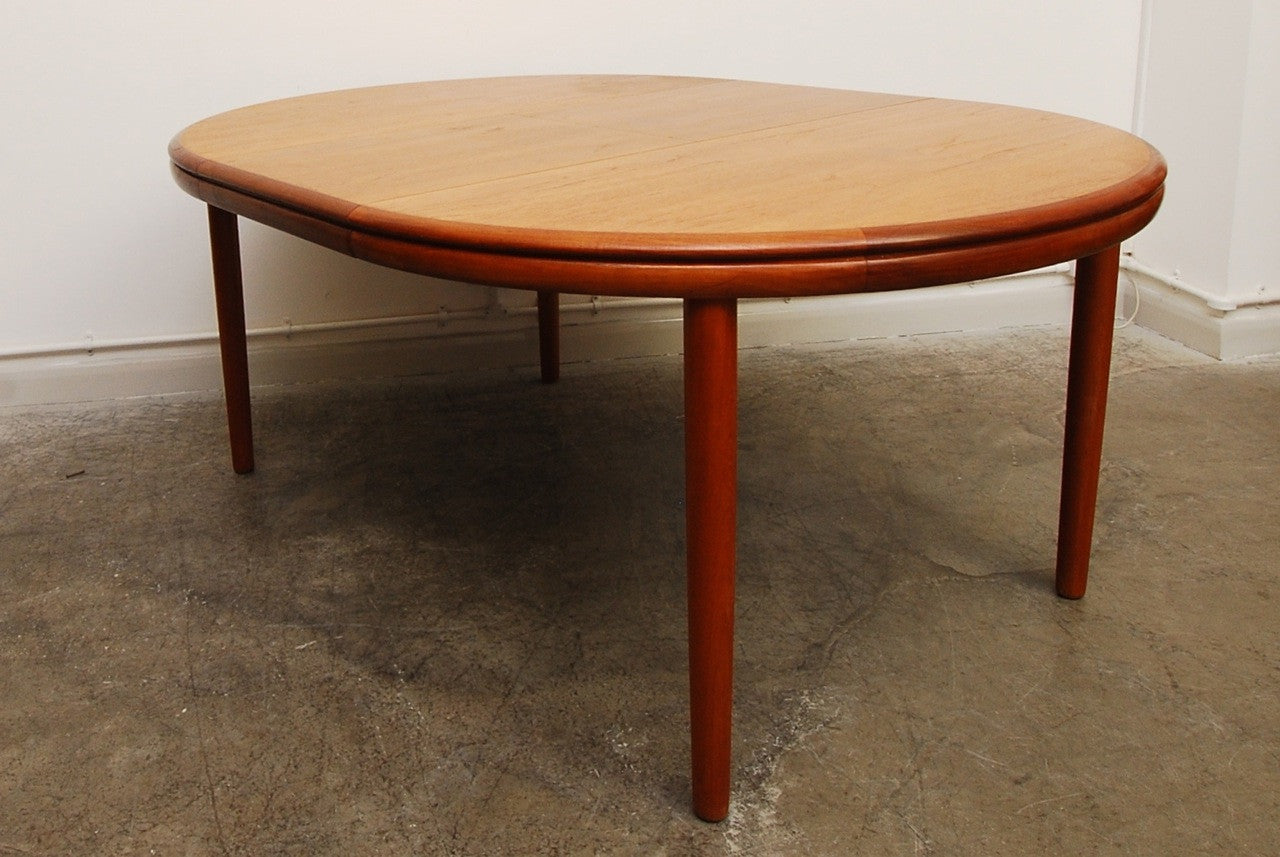 Round teak dining table