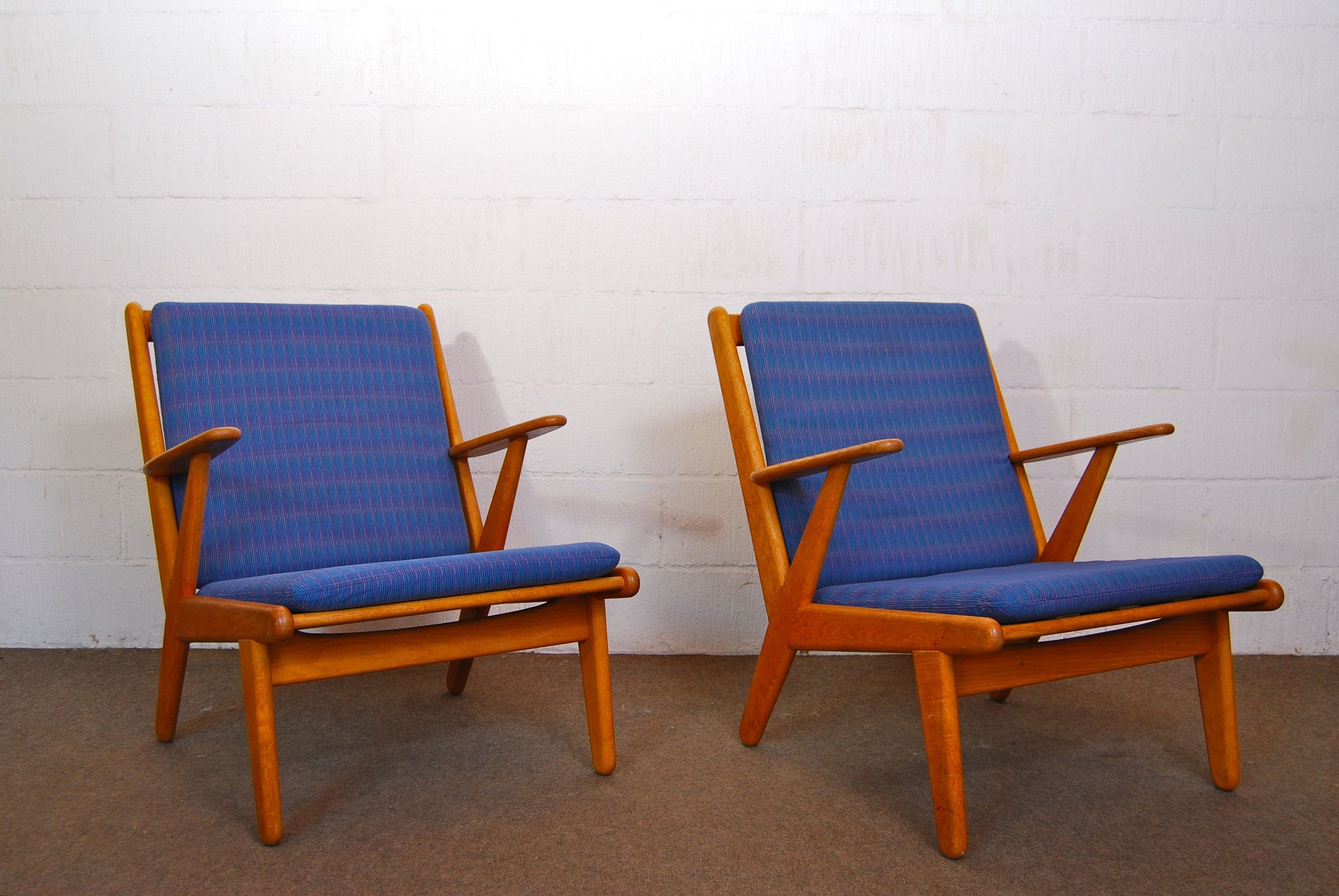 Pair of lounge chairs by Poul M. Volther