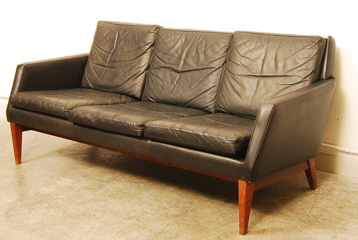 Three seat black leather sofa. Denmark, 1960s
