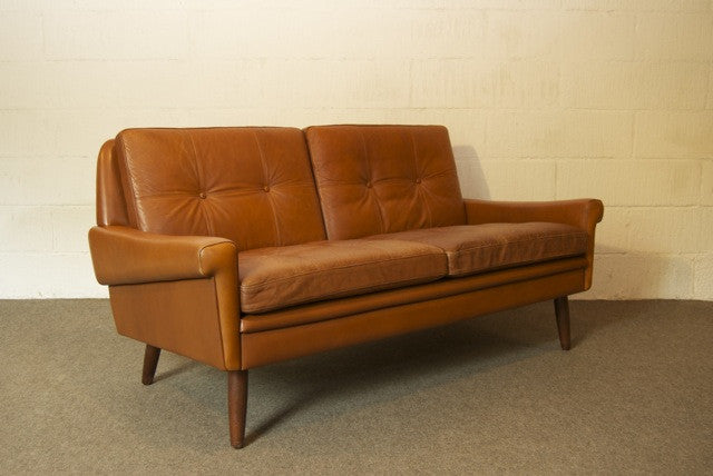 Two seat leather sofa by Skipper's MÌübler