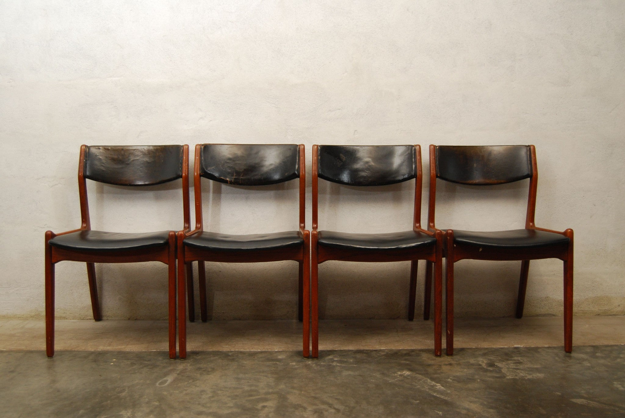 Set of four leather and teak dining chairs