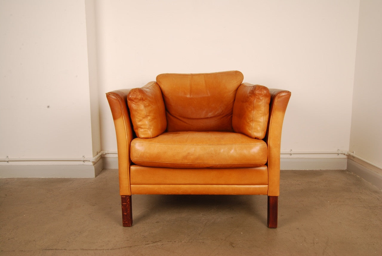 Tan leather club chair