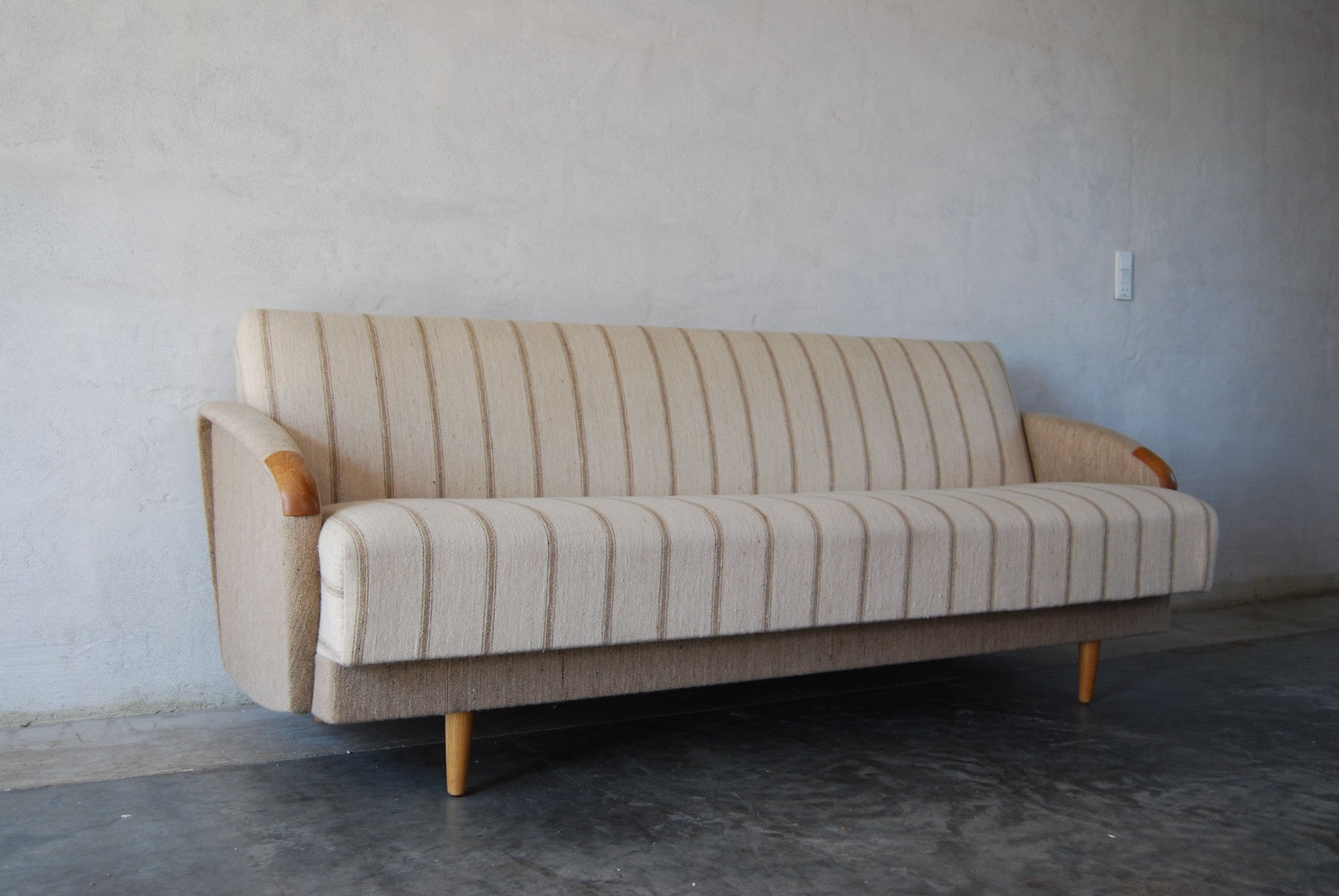 Sofabed with teak paws/oak legs