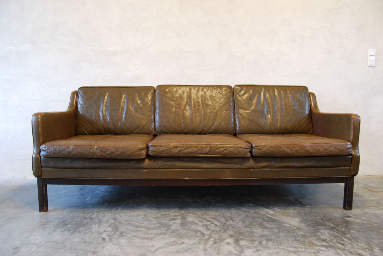 Three seat leather sofa in nougat