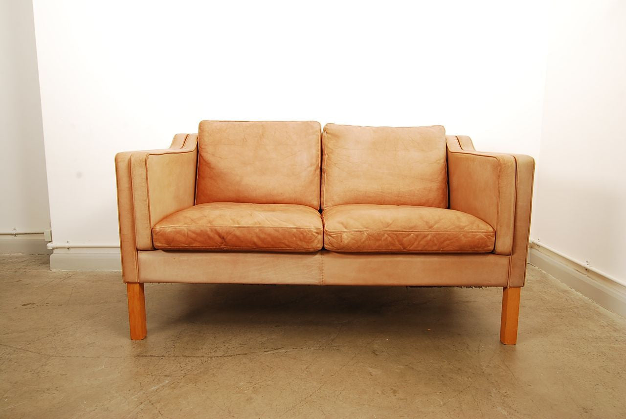 Two seat leather sofa in style of Mogensen