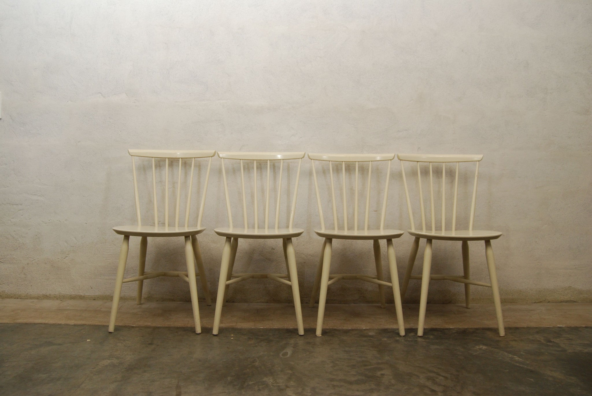 Set of four spindle back dining chairs
