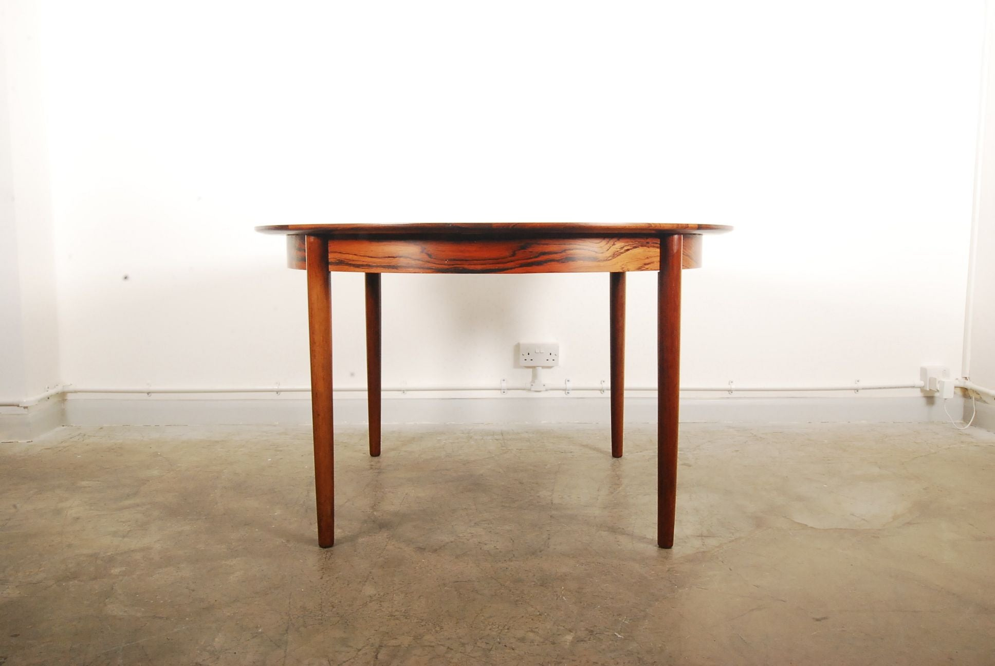 Rosewood dining table with drop-in leaves